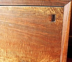 Close-up view of door on Beveled Illusion Cabinet by Michael Elkan