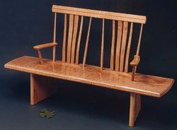 The Bench Seat: single board seat with unique carved back and steam bent slats by Michael Elkan
